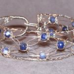 8 strand Silver Lace and sodalite bracelet.  Hand knotted and woven sterling silver with natural stone.  Easy clasp, specify size.  $80.00